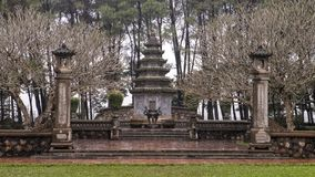Tomb of  the abbot Hòa Thượng Thích Ðôn Hậu in Thien Mu Pagoda, Hue, Vietnam. Pictured is a stupa At the end of the Monastery Grounds in royalty free stock image