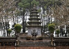 Tomb of the abbot Hòa Thượng Thích Ðôn Hậu in Thien Mu Pagoda, Hue, Vietnam. Pictured is a stupa At the end of the Monastery Grounds in stock images