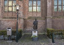 Gothic lamp and Bronze statue Jan Janse de Weltevree, De Rijp, Netherlands stock photography