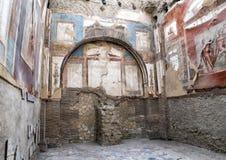 Temple in the College of Augustales in Parco Archeologico di Ercolano. Pictured is a temple in the College of Agustales in the Parco Archeologico di Ercolano Stock Photo