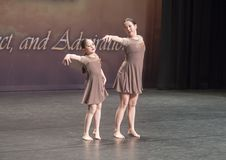 Amerasian sisters perform jazz duet. Pictured are a thirteen year old and nine year old Amerasian sisters performing a jazz duet in a dance competition.  They Stock Photos