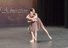 Amerasian sisters perform jazz duet. Pictured are a thirteen year old and nine year old Amerasian sisters performing a jazz duet in a dance competition.  They Stock Image