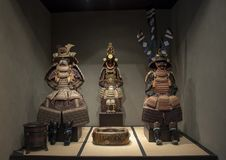 Ancient Samurai armor suits, Dallas, Texas. Pictured are three ancient samurai armor suits in The Ann and Gabriel Barbier-Mueller Museum.  On the left is a Royalty Free Stock Images
