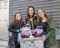 Teenage girls posing for a donation with Diva and Chloe in South Philadelphia. Pictured are three teenage sisters happily posing with Diva and Chloe. Diva is a royalty free stock photography