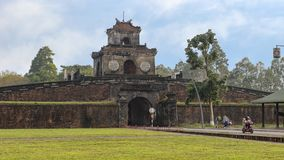 Tourists having entered the Citadel through one of it`s entrance gates, Hue, Vietnam. royalty free stock photography
