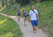 Twenty-three year-old Amerasian male leading family along a trail in Mount Rainier National Park, Washington royalty free stock photography