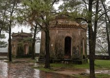 Small pavilions beside the seven story Phuoc Duyen tower in the Thien Mu Pagoda, Hue, Vietnam. Pictured are two of four small pavilions beside the seven story stock photos