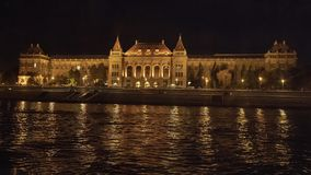 University of Technology at night from the River Danube, Buda, Hungary. Pictured is the University of Technology at night on the Buda side of the River Danube in stock photos