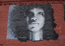 Wall art featuring Erykah Badu in Deep Ellum, Dallas, Texas. Pictured is a wall art featuring Erykah Badu in Deep Ellum.  Erica Abi Wright, known professionally Royalty Free Stock Image
