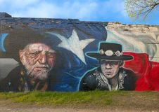 Wille Nelson and Stevie Ray Vaughn mural, Bishop Arts District, Dallas, Texas. Pictured is a wall mural by artists Josh Mittag and Theo Ponchaveli in the Bishop royalty free stock photography
