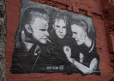 Wall art featuring Spector 45 in Deep Ellum, Dallas, Texas. Pictured is a wall mural featuring the greaser punk band Sector 45 in Frank Campagna`s music series Royalty Free Stock Image