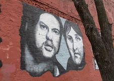 Wall art featuring The O`s in Deep Ellum, Dallas, Texas. Pictured is a wall mural featuring a the O`s John Pedigo and Taylor Young in Frank Campagna`s music Stock Images
