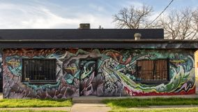 Surrealistc wall mural by Theo Ponchaveli, Dallas, Texas. Pictured is a wall mural on the front of the Ponchaveli Studio in Dallas, Texas.  It was painted by Royalty Free Stock Images