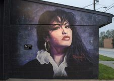 Selena wall mural by Theo Ponchaveli, Dallas, Texas. Pictured is a wall mural of Selena on one side of the Ponchaveli Studio in Dallas, Texas. Selena Quintanilla Stock Photos