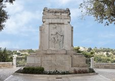 War memorial honoring the fallen of all wars in a public park in Locorotondo, Italy. Pictured is a war memorial honoring the fallen of all wars in a public park Royalty Free Stock Photos