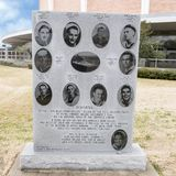 War monument to Ten Boys From Dallas in the Veterans Memorial Garden with Dallas Memorial Auditorium in the background. Pictured is the war monument to the Ten royalty free stock images