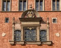 Window with greater version coat of arms of the city of Prague, Old Town Hall, Prague Czech republic. Pictured is a window with the greater version of the coast royalty free stock photography