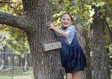 Amerasian girl posing in the trees in Oklahoma City, Oklahoma Royalty Free Stock Photo