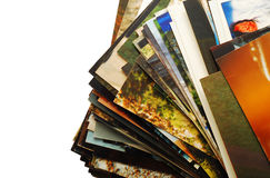 Pictures. Stack of random pictures over white Stock Photography