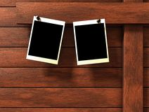 Pictures. Two empty pictures on wood background. Additional PNG format available where the black rectangle on the picture frame is a mask and a personalized Royalty Free Stock Images