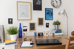 Pictures above desk. Nice stylish pictures on wall above desk in office Stock Photography