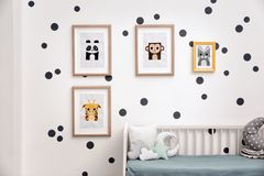 Pictures of animals on wall in room. Pictures of animals on wall in baby room Royalty Free Stock Images