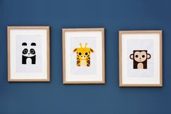 Pictures of animals on wall in room. Pictures of animals on wall in baby room royalty free stock image