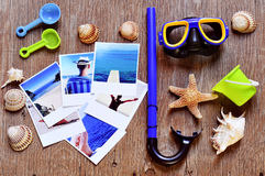 Pictures of beach scenes and other summer stuff on a rustic wood Royalty Free Stock Photo