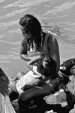 Pictures of Brazil. River  San Francisco. Woman scene breastfeeding her child in the waters of the River. Santana city of San Francisco, State of Sergipe Brazil Stock Image