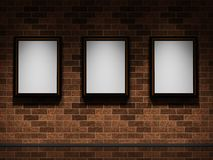 Pictures on a brick wall Royalty Free Stock Photo
