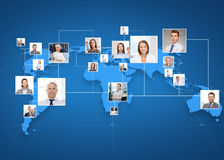 Pictures of businesspeople over world map Stock Photography