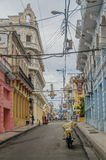 Pictures of Cuba - Santiago de Cuba. Streetview of a coulorful houses in Santiago de Cuba against a cloudy sky Royalty Free Stock Photography