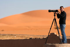 Pictures on the desert. A colleague photographer photographing certain aspects of the desert Stock Photos