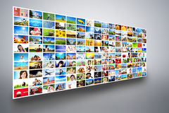 Pictures display on wide modern monitors, screens forming a multimedia broadcast. Pictures display on wide modern monitors, screens forming a big multimedia Royalty Free Stock Images
