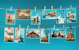 Pictures of european landmarks pinned on ropes, toned image Royalty Free Stock Photo