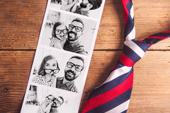 Pictures of father and daughter on table. Fathers day. Studio shot. Royalty Free Stock Image