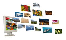 Pictures Flying From a Monitor Stock Image