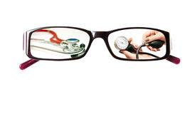 Pictures on the glasses with a medical theme Stock Images