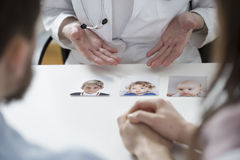 Pictures of growing up child. On doctor's desk Royalty Free Stock Photo