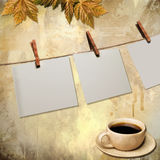 Pictures hanging on grunge background Royalty Free Stock Photography