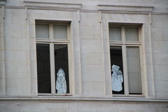 Pictures of a man and a woman on windowpane Stock Image