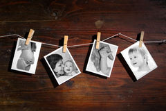 Pictures of a newborn and mother. Attach to rope with clothes spins on wooden background