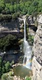 Panoramic view of 115m high waterfall of Salt de Sallent, with tiny rainbow. 5 pictures panoramic view of Salt de Sallent Barcelona, Spain. Tiny rainbow formed stock photos