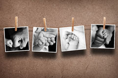 Pictures of  parent hand and baby. Hand hanging on the rope Royalty Free Stock Images