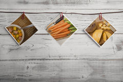 Pictures with recipe hanging on ribbon, wooden wall Royalty Free Stock Images