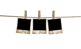 Pictures on a rope with clothespins, with clipping path for images Royalty Free Stock Images