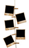 Pictures on a rope with clothespins, with clipping path for images Stock Photo