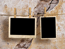 Pictures on a rope with clothespins Royalty Free Stock Photography