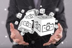 Concept of pictures sharing. Pictures sharing concept above the hands of a man in background Stock Image