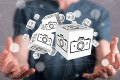 Concept of pictures sharing. Pictures sharing concept between hands of a man in background Royalty Free Stock Photography